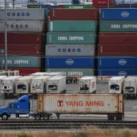 Unloaded containers from Asia stand at the main port terminal in Long Beach, California, on Friday. | AFP-JIJI