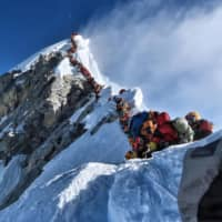 This photo taken on May 22 and released by @nimsdai Project Possible shows heavy traffic of mountain climbers lining up to stand at the summit of Mount Everest. | @NIMSDAI PROJECT POSSIBLE / VIA AFP-JIJI