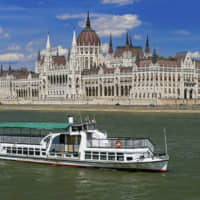 This tour boat Hableany is seen in the Danube River with the Parliament building in the background in Budapest. A boat capsized and sank in the Danube River Wednesday evening in Budapest, with dozens of people on board, including passengers and crew, Hungarian media reported. | ZOLTAN MIHADAK / MTI / VIA AP