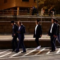 Representatives of the South Korean travel agency Chamjoeun arrive at the site of a ship accident that killed several people near Margaret Bridge on the Danube river in Budapest Thursday. | REUTERS