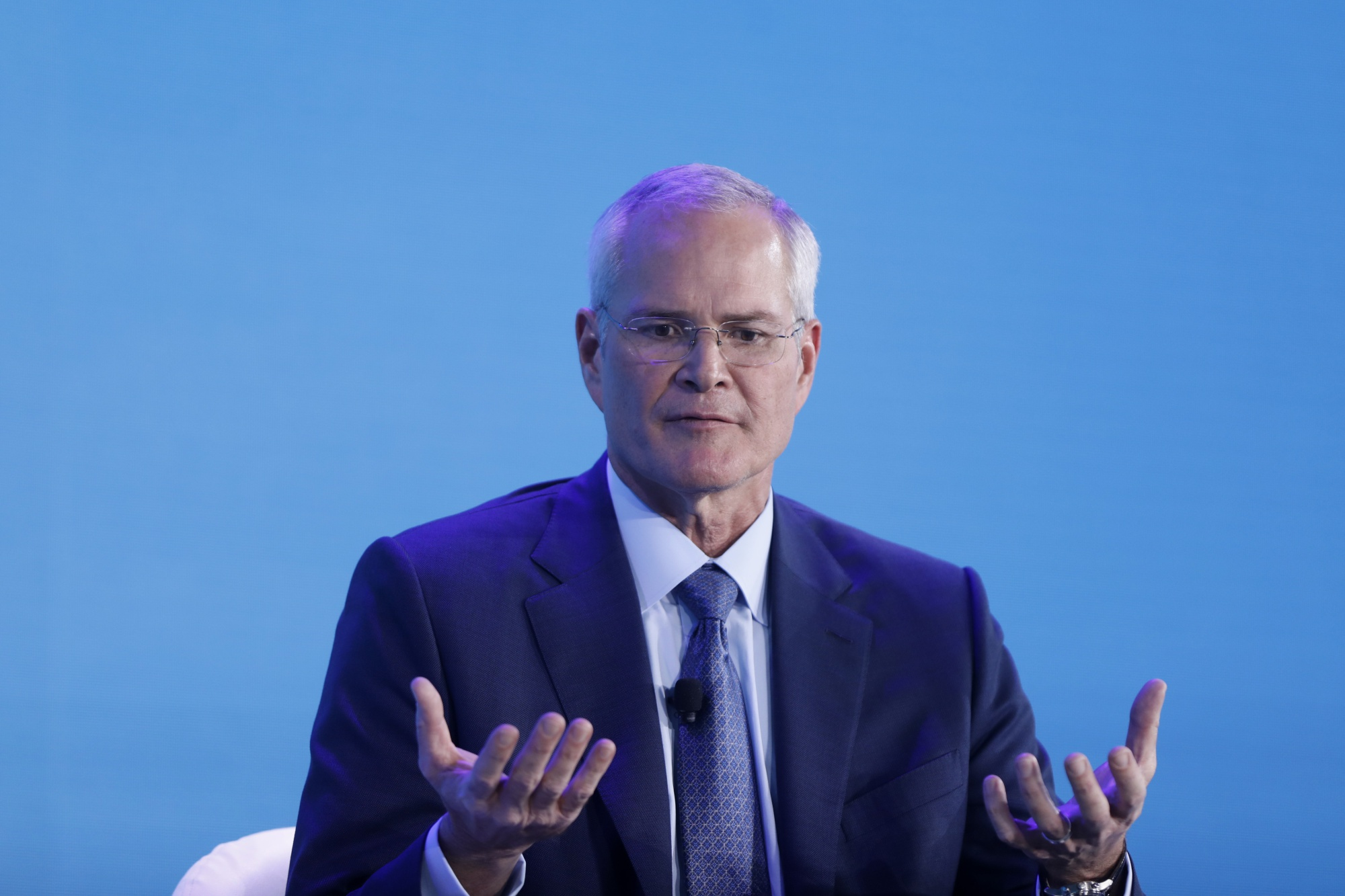 Exxon Mobil CEO Darren Woods says the answer to climate change will be found in U.S. government laboratories.   BLOOMBERG