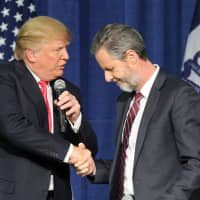 Then-U.S. Republican presidential candidate Donald Trump (left) shakes hands with Jerry Falwell Jr. at a campaign rally in Council Bluffs, Iowa, in 2016. | REUTERS