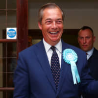 Brexit Party leader Nigel Farage arrives to speak to the media outside the counting center for the European Parliamentary election in Southampton, England, Sunday. | REUTERS