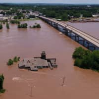 A building sits submerged in the flood waters of the Arkansas River in this aerial photo in Fort Smith, Arkansas, Thursday. | DRONE BASE / VIA REUTERS