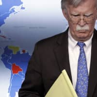 U.S. national security adviser John Bolton listens during a press briefing regarding the Trump administration sanctions on Venezuela's state-owned oil company, at the White House in Washington in January. The sanctions cut off one of Nicolas Maduro's most important sources of income and foreign currency along with around $7 billion in assets of state-owned Petroleos de Venezuela SA. Bolton warned that any move by Maduro against Juan Guaido 'will be met with a significant response.' | AP