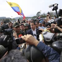 Venezuela's Juan Guaido calls for uprising but military loyal to Maduro for now