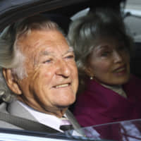 Former Australian Prime Minister Bob Hawke and his wife, Blanche d'Alpuget, arrive at the Australian Labor Party's campaign launch in Brisbane, Australia, ,in 2013. Hawke, Australia's 23rd prime minister, has died in Sydney at age 89. | AP