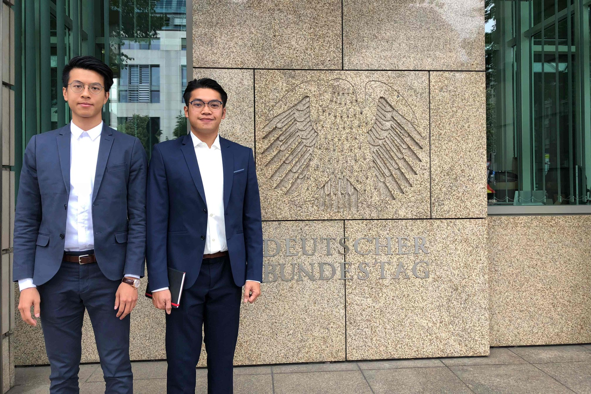 Ray Wong (left) and Alan Li pose for a photo in Berlin in June 2018. The two former Hong Kong independence activists have been granted refugee status in Germany in what is one of the first cases of dissenters from the semi-autonomous Chinese city receiving such protection.   AFP-JIJI