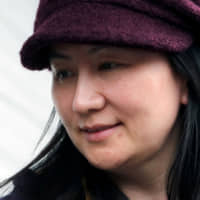 Huawei Technologies Co. Chief Financial Officer Meng Wanzhou arrives at home after a court appearance in Vancouver, British Columbia, on March 6. | REUTERS