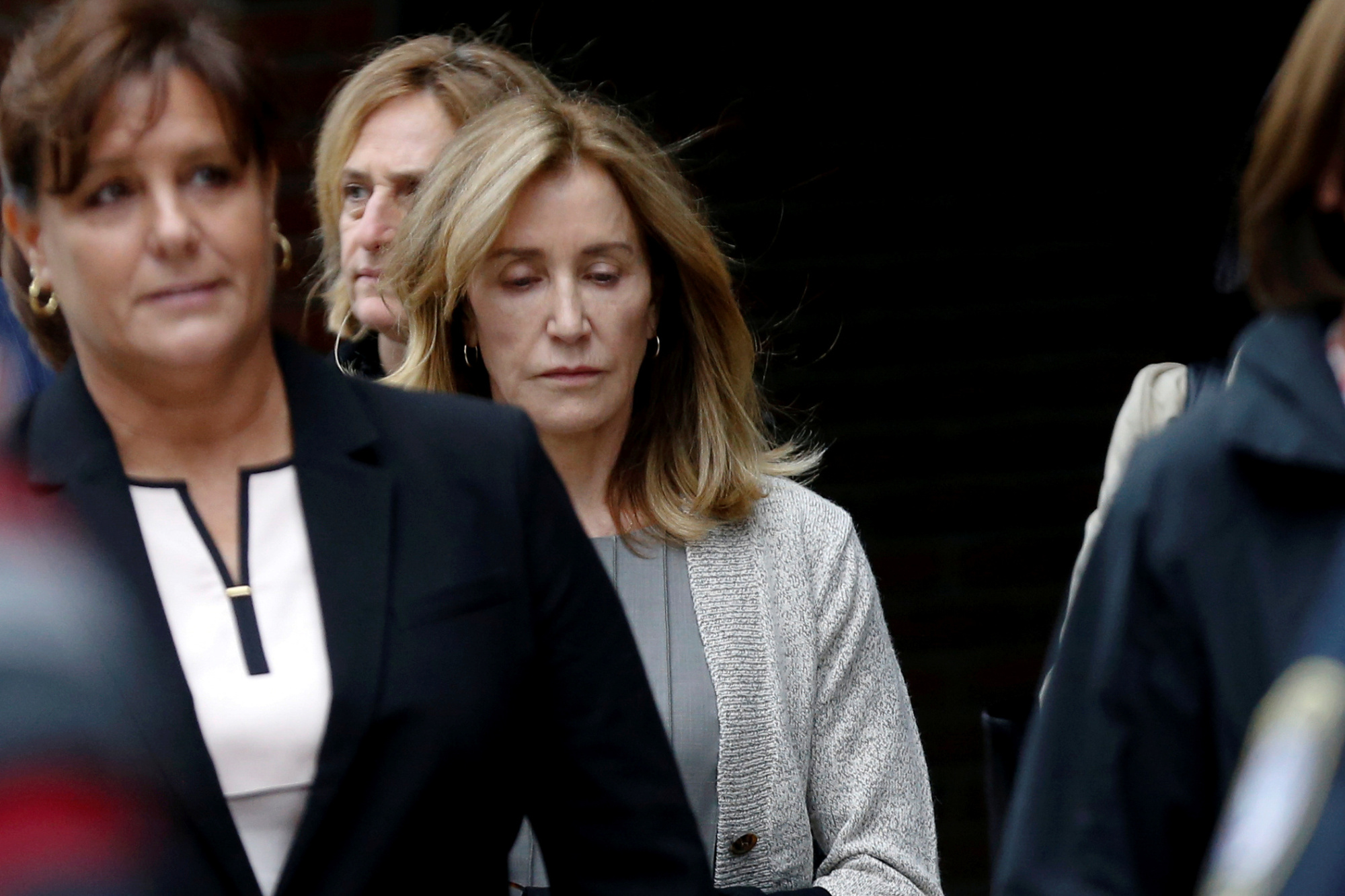 Actor Felicity Huffman leaves the federal courthouse after facing charges in a nationwide college admissions cheating scheme in Boston Monday. | REUTERS