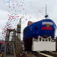 People attend the launch ceremony of  the nuclear-powered icebreaker Ural at the Baltic shipyard in St. Petersburg on Saturday. | AFP-JIJI