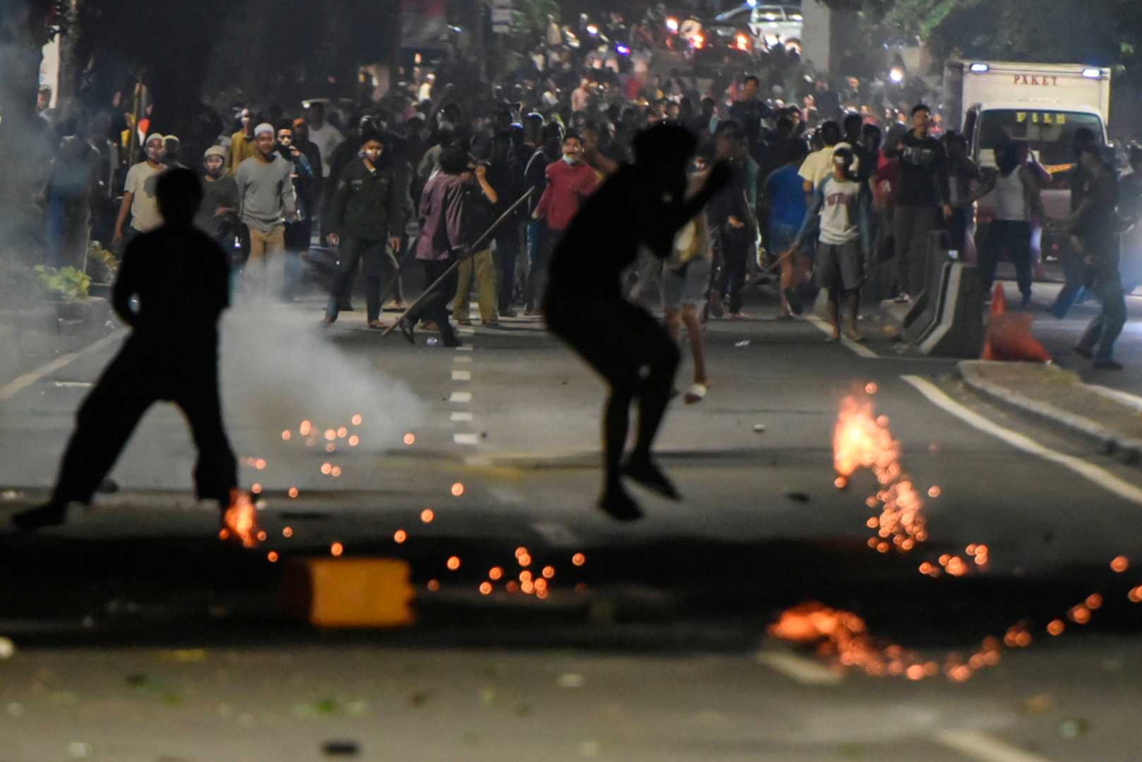 Protesters clash with police in Thamrin, Jakarta, early on May 22. | REUTERS