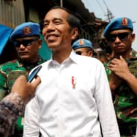 Indonesian President Joko 'Jokowi' Widodo reacts after making a public address in Jakarta on Tuesday. | REUTERS