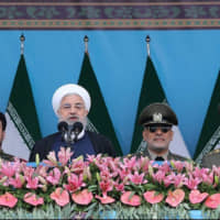 Iranian President Hassan Rouhani delivers a speech during the ceremony of the National Army Day parade in Tehran last month. | TASNIM NEWS AGENCY / VIA REUTERS
