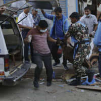 Four reported killed, seven wounded in three blasts in Kathmandu blamed on Maoist rebels