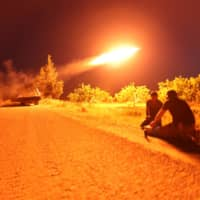 Fighters from Hayat Tahrir al-Sham (HTS), Syria's former al-Qaida affiliate, which controls most of Idlib province as well as parts of neighboring Aleppo, Hama and Latakia provinces, fire a missile at regime positions on May 13in the northern part of Syria's Hama province. Clashes on the edge of a jihadist bastion in northwestern Syria have killed at least 42 fighters in 24 hours, a monitor said after regime bombardment on the region devastated health services. | AFP-JIJI