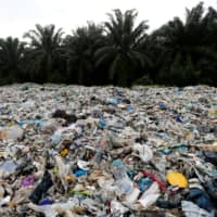Plastic waste is piled outside an illegal recycling factory in Jenjarom, Kuala Langat, last October. | REUTERS