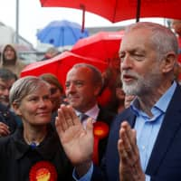 Jeremy Corbyn speaks to the media during a meeting with local activists following the results of local elections in Sale, Manchester, Britain, May 3. | REUTERS