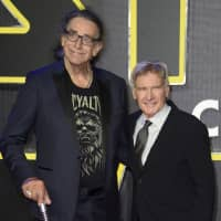 Peter Mayhew (left) and Harrison Ford appear at the European premiere of the film 'Star Wars: The Force Awakens ' in London  in 2015. Mayhew, who played the rugged, beloved and furry Wookiee Chewbacca in the 'Star Wars' films, has died. Mayhew's family said in a statement that he died at his home in Texas on April, 26. He was 74. No cause was given. | JONATHAN SHORT / INVISION / VIA AP
