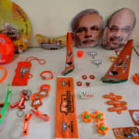 Wristbands, key chains and badges featuring India's ruling Bharatiya Janata Party and masks of the party president, Amit Shah, and Prime Minister Narendra Modi are displayed at a BJP office ahead of the general election in Gandhinagar, Gujarat, on April 3. | REUTERS