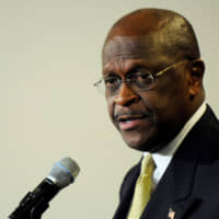 Former Republican presidential hopeful Herman Cain is seen at the National Press Club in Washington in 2012. | REUTERS