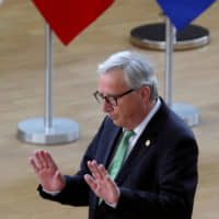 European Commission President Jean-Claude Juncker arrives at a European Union summit in Brussels on Tuesday to discuss who should run the EU executive for the next five years. | REUTERS