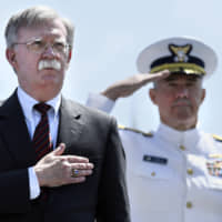 U.S. national security adviser John Bolton stands for the national anthem at the commencement for the United States Coast Guard Academy in New London, Connecticut, on May 22. | AP