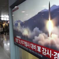 A TV screen shows file footage of a North Korean missile launch, during a news program at Seoul Railway Station on Saturday. | AP