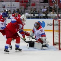 Russian President Vladimir Putin scores a goal during the hockey game at the Bolshoy Ice Dome in Sochi, Russia, on Friday. | AFP-JIJI