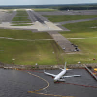 Aerial view of the Miami Air International Boeing 737-800 that overran the runway at NAS Jacksonville and came to rest in the St. Johns River in Jacksonville, Florida, on Friday. | NTSB / VIA REUTERS