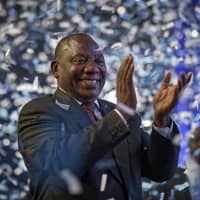 South African President Cyril Ramaphosa applauds as confetti is launched at the end of the results ceremony at the Independent Electoral Commission Results Center in Pretoria on Saturday. | AP