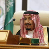Saudi king calls for firm Arab stance against threats from Iran