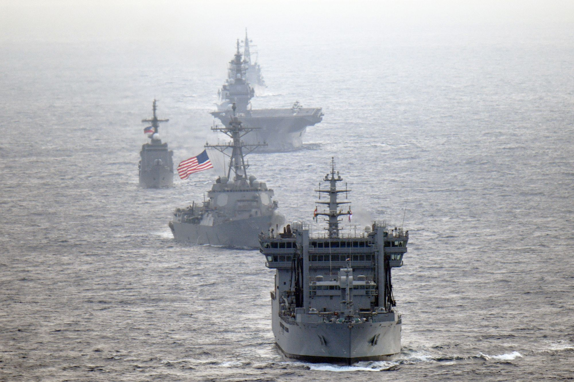 The U.S. Navy guided-missile destroyer USS William P. Lawrence transits through international waters in the South China Sea with the Indian Navy destroyer INS Kolkata and tanker INS Shakti, the Maritime Self-Defense Force helicopter carrier Izumo and destroyer Murasame and the Philippine Navy patrol ship BRP Andres Bonifacio. | MSDF