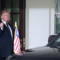 U.S. President Donald Trump gives a thumbs up as Hungary's Prime Minister Viktor Orban departs the White House in Washington Monday. | REUTERS