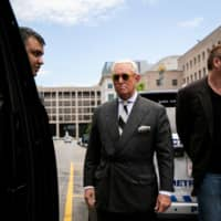 Roger Stone, longtime political ally of U.S. President Donald Trump, departs following a hearing to convince a judge to dismiss charges stemming from special counsel Robert Mueller's probe into Russian interference in the 2016 election, at U.S. District Court in Washington Thursday. | REUTERS
