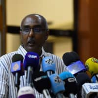 Rashid al-Sayed, a Sudanese protest leader, speaks to the press in Khartoum on Wednesday. Sudanese protest leaders threatened to launch a nationwide campaign of civil disobedience after accusing the country's military rulers of delaying the transfer of power to a civilian administration. | AFP-JIJI