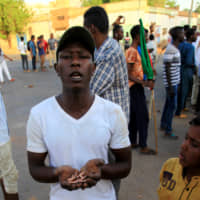 Sudanese forces clear protesters with gunfire; transition talks suspended indefinitely