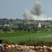 Smoke billows after reported shelling on the Syrian village of Kafr Ein in the southern countryside of the jihadi-held Idlib province on Thursday. | AFP-JIJI