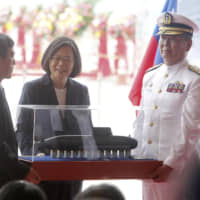 President Tsai Ing-wen looks at a model of Taiwan's first indigenous submarine during a groundbreaking ceremony for the island's naval submarine factory in Kaohsiung on Thursday. | AP