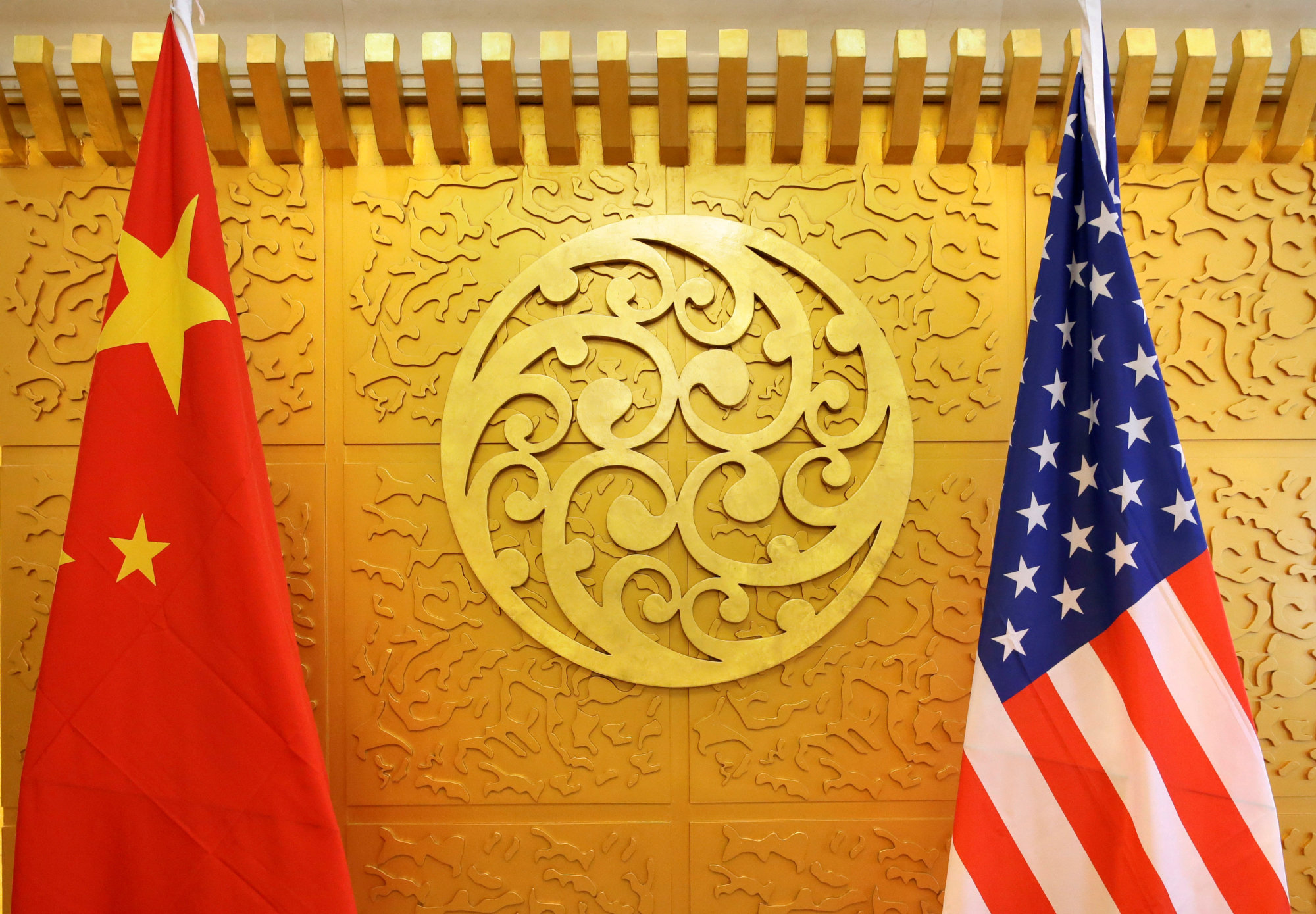 Chinese and U.S. flags are set up for a meeting during a visit by U.S. Secretary of Transportation Elaine Chao at China's Ministry of Transport in Beijing in April 2018. | REUTERS