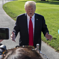 U.S. President Donald Trump speaks to the media before boarding Marine One on the South Lawn of the White House in Washington on Thursday. Trump renewed his assertion that Robert Muellers report exonerated him of wrongdoing, claiming the special counsel 'would have brought charges' if he could, and adding that he 'can't imagine the courts allowing him' to be impeached.   BLOOMBERG