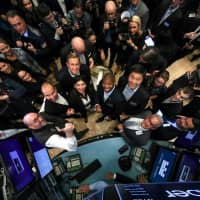 Uber Technologies Inc. CEO Dara Khosrowshahi, co-founders Ryan Graves and Garrett Camp, Chief Financial Officer Nelson Chai and NYSE President Stacey Cunningham pose together during the company's IPO on the floor of the New York Stock Exchange in New York on Friday. | REUTERS