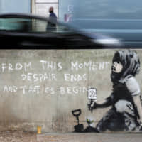 Graffiti believed to have been created by street artist Banksy is seen at the site where hundreds of Extinction Rebellion climate protesters camped recently at Marble Arch in London, on April 26. | REUTERS