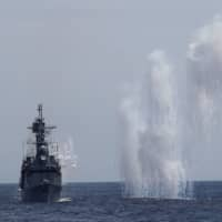 Flares launched from the Taiwan Navy's Kee Lung guided-missile destroyer during a military drill near Hualien, Taiwan, on Wednesday. | REUTERS