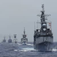 The Taiwan Navy's guided-missile destroyer Kee Lung (right) and other navy vessels take part in a military drill near Hualien, Taiwan, on Wednesday. | REUTERS