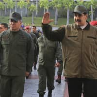 Venezuelan President Nicolas Maduro, accompanied by Defense Minister Vladimir Padrino Lopez, arrives at Fort Tiuna in Caracas on Thursday. | AP