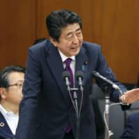 Prime Minister Shinzo Abe speaks at a meeting of the Lower House's Committee on Health, Labor and Welfare on Friday. | KYODO