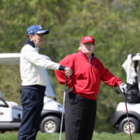 Abe and Trump play golf outside Washington on April 27. | CABINET OFFICE / VIA KYODO