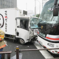 A truck that rammed into three pedestrians and hit four vehicles is seen at the site of the crash in Tokyo's Shinbashi district on Tuesday. | KYODO