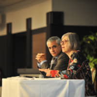 The International Labor Organization's Deborah Greenfield (right) and Stefano Scarpetta of OECD discuss efforts to reduce child labor around the world during a panel at the ACE SDG8.7 Dialogue Dinner in April in Tokyo. | RYUSEI TAKAHASHI